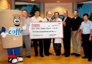 Dunkin' Donuts franchisees from Rhode Island and Bristol County, Mass. present a check to Hasbro Children's Hospital. Left to right: Todd Wallace, field marketing manager, Dunkin' Donuts; Joe Prazeres, franchisee; Guido Petrosinelli, franchisee; Robert B. Klein, M.D., pediatrician-in-chief, Hasbro Children's Hospital; Timothy J. Babineau, M.D., president and CEO, Rhode Island Hospital; Cliff Prazeres, franchisee and Carlos Santos, franchisee.