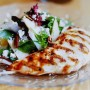 Grilled chicken breast with pecan pear salad