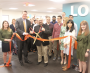 Edward M. Augustus Jr., the City Manager of Worcester, MA, and Dr. Andrew Schiller, CEO and founder of Location, Inc., are flanked by employees at the company's ribbon cutting ceremony at Mercantile Center on May 23r