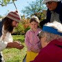 An Old Sturbridge Village historian talks with visitors in one of the OSV apple orchards.