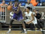 Karl Charles pours in 14 points to help Holy Cross to their first win of the season.